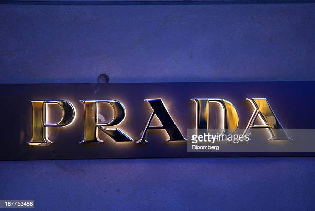 A logo sits outside a Prada SpA luxury clothing store in Frankfurt Germany on Monday Nov 11 2013 As the euro area struggles out of the worst...