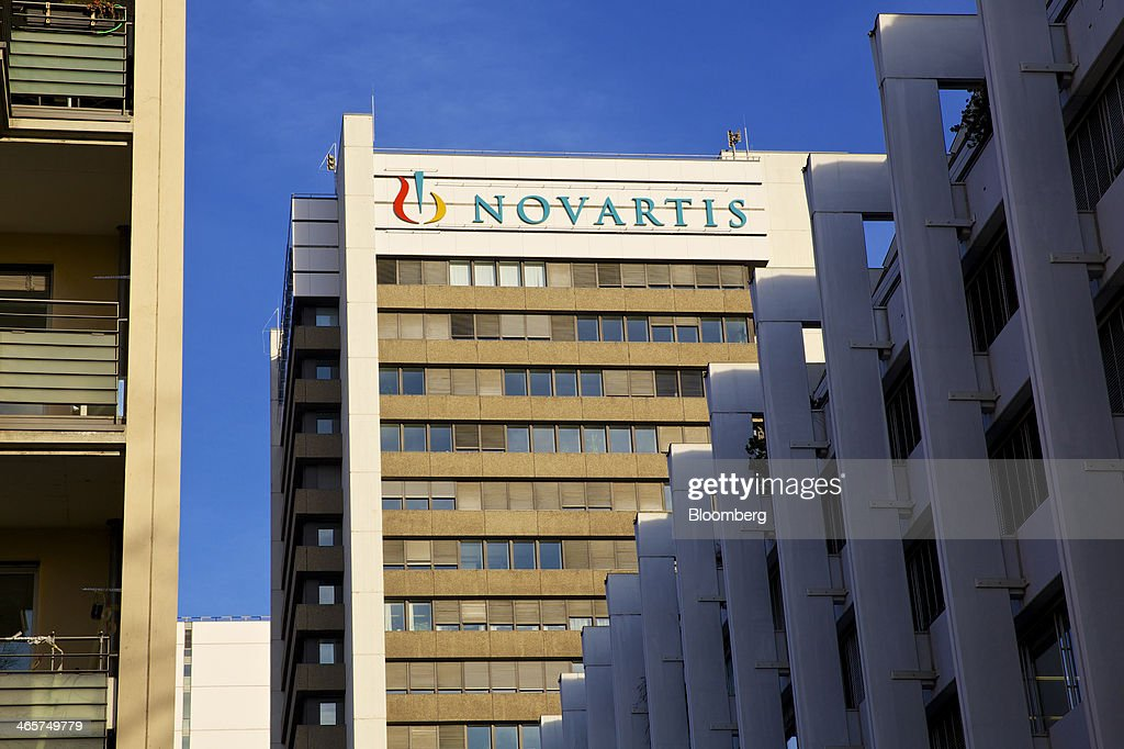 A logo sits outside the headquarters of Novartis AG in Basel, Switzerland, on Wednesday, Jan. 29, 2014. Novartis AG, Europe's biggest drugmaker by sales, said fourth-quarter profit fell as currencies in emerging markets weakened against the dollar. Photographer: Gianluca Colla/Bloomberg via Getty Images