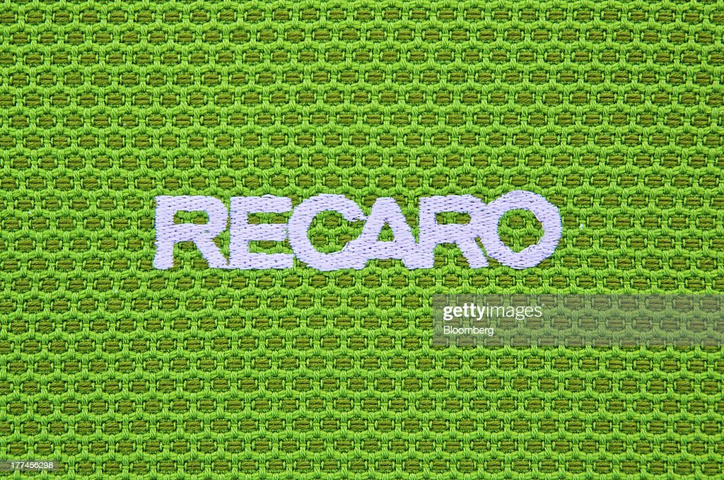 A logo sits woven into an aircraft seat cover in the showroom at Recaro Aircraft Seating GmbH & Co.'s assembly plant in Schwabish Hall, Germany, on Thursday, Aug. 22, 2013. Germany's economic growth in the second quarter was driven by consumption and a rebound in investment as a recovery in the 17-nation euro area, its biggest trading partner, bolstered confidence. Photographer: Gianluca Colla/Bloomberg via Getty Images