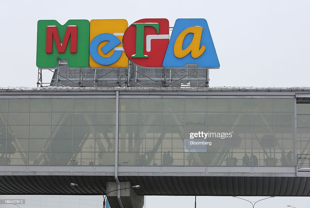 A logo stands above a pedestrian walkway at the MEGA Belaya Dacha shopping complex, constructed by the real estate development arm of Inter Ikea Systems BV and one of Europe's largest malls, in Moscow, Russia, on Thursday, Jan. 31, 2013. Russian shopping-mall construction may climb to a record this year as retailers take advantage of rising sales by moving into bigger, more modern buildings, Cushman & Wakefield Inc. said. Photographer: Andrey Rudakov/Bloomberg via Getty Images