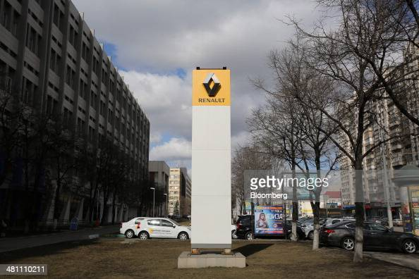 A logo stands on display outside a Renault SA automobile dealership in Moscow Russia on Friday March 28 2014 Foreign companies face the prospect of...