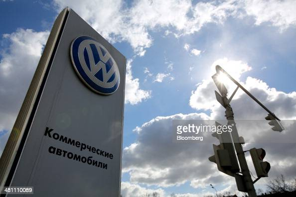 A VW logo stands on display outside a Volkswagen AG automobile dealership in Moscow Russia on Friday March 28 2014 Foreign companies face the...