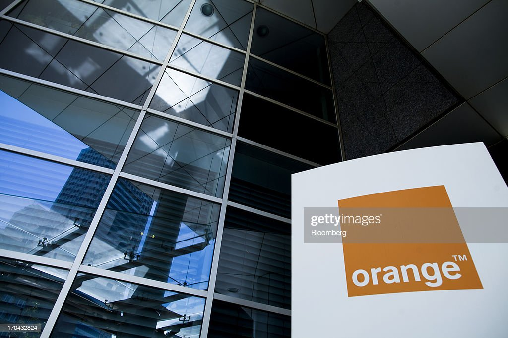 A logo stands on display outside the headquarters of Orange Polska, also known as Telekomunikacja Polska SA (TPSA), Poland's national telecommunications company, in Warsaw, Poland, on Wednesday, June 12, 2013. Cable providers are being drawn to Poland, the European Union's biggest eastern economy, because penetration levels are half that of neighboring Germany even as unemployment rises, according to a website presentation by the country's biggest TV network, Cyfrowy Polsat SA. Photographer: Bartek Sadowski/Bloomberg via Getty Images