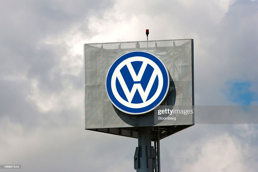A logo stands on display outside the Volkswagen Autoeuropa factory, operated by Volkswagen AG, in Palmela, Portugal, on Saturday, April 13, 2013. Portugal's government plans to cut about 1.2 billion euros ($1.6 billion) in spending this year after the country's highest court blocked a plan to suspend the equivalent of a monthly salary payment to state workers and pensioners. Photographer: Mario Proenca/Bloomberg via Getty Images