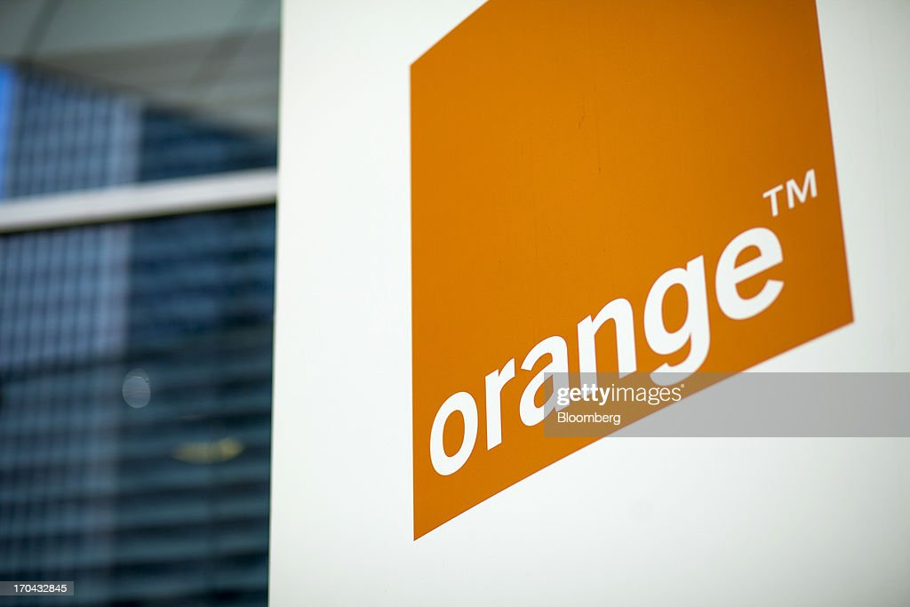 A logo stands outside the headquarters of Orange Polska, also known as Telekomunikacja Polska SA (TPSA), Poland's national telecommunications company, in Warsaw, Poland, on Wednesday, June 12, 2013. Cable providers are being drawn to Poland, the European Union's biggest eastern economy, because penetration levels are half that of neighboring Germany even as unemployment rises, according to a website presentation by the country's biggest TV network, Cyfrowy Polsat SA. Photographer: Bartek Sadowski/Bloomberg via Getty Images
