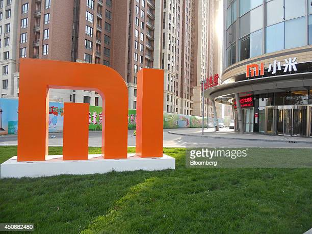 A 'MI' logo stands outside the main entrance of the Xiaomi Corp headquarters in Beijing China on Sunday April 6 2014 Xiaomi has become one of China's...