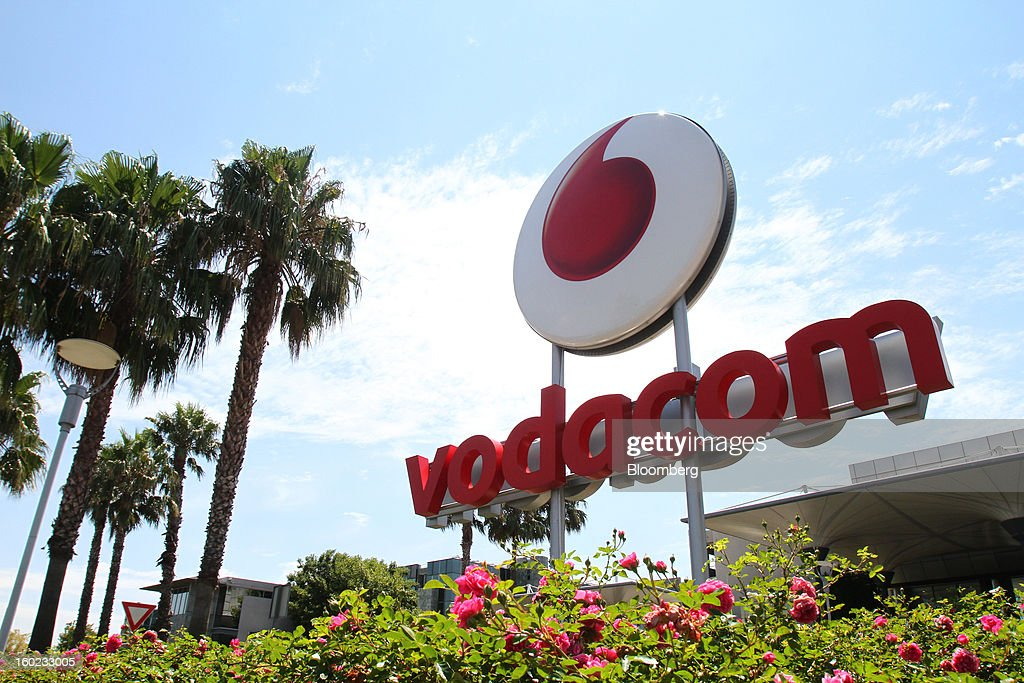 A logo stands outside Vodaworld, the headquarters of Vodacom Group Ltd., Vodafone's biggest African business, in Johannesburg, South Africa, on Monday, January 28, 2013. Almost two decades after Vodafone Group Plc entered Africa, the region -- where most people earn less than $2 a day and mobile phone towers run on diesel -- is turning into one of the company's biggest profit generators. Photographer: Nadine Hutton/Bloomberg via Getty Images