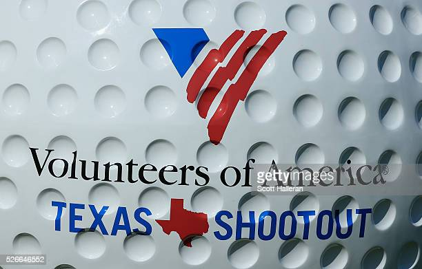 A logoed golf ball is seen behind the 18th hole during the third round of the Volunteers of America Texas Shootout at Las Colinas Country Club on...