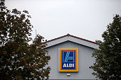 Logos adorn an Aldi supermarket on Old Kent Road on September 29 2014 in London England Aldi has reported a 65% increase in profits and is planning...