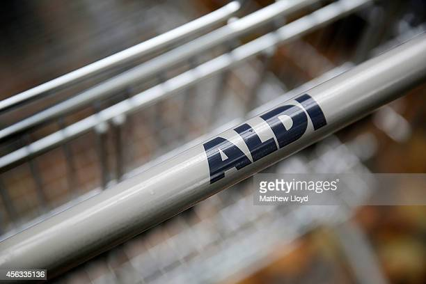 Logos adorn trollies outside an Aldi supermarket on Old Kent Road on September 29 2014 in London England Aldi has reported a 65% increase in profits...
