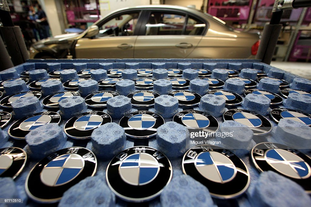 BMW logos are pictured in a tray on on the BMW 3-series production line at the BMW factory on March 15, 2010 in Munich, Germany. The German car maker will present the company's business report for 2009 on Wednesday.