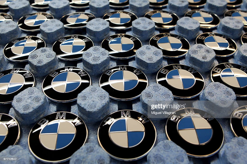 BMW logos are pictured in a tray on on the BMW 3-series production line at the BMW factory on March 15, 2010 in Munich, Germany. The German car maker will present the company's business report for 2009 tomorrow.