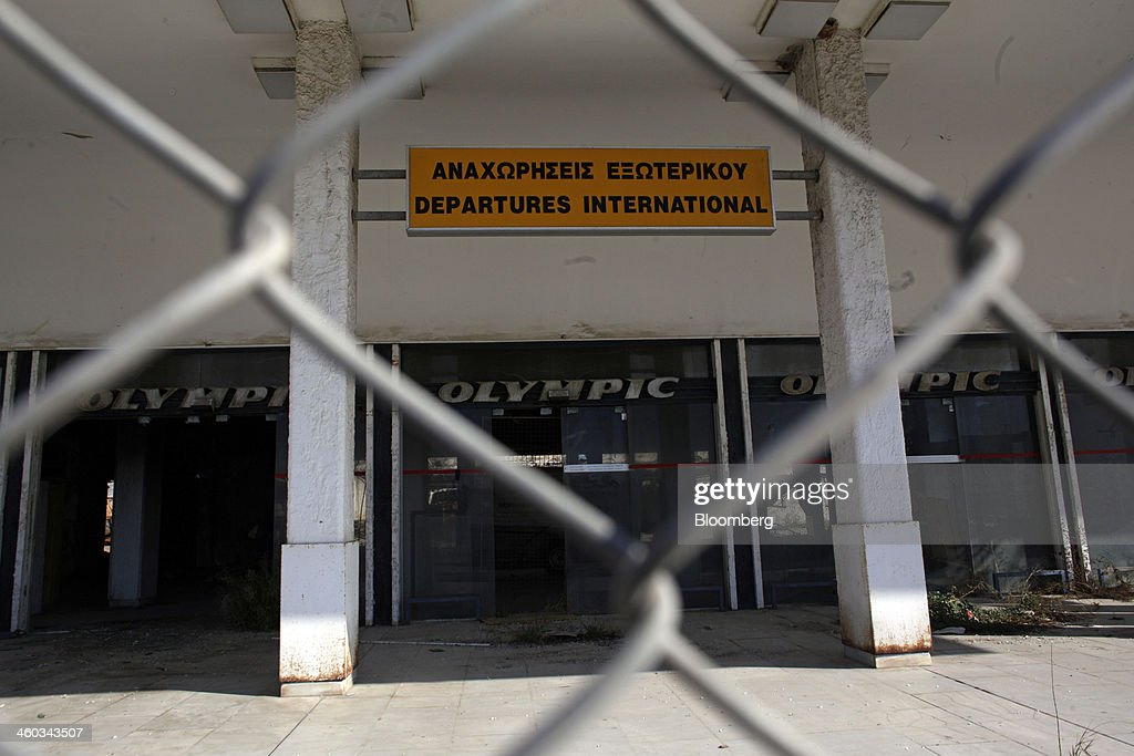 Logos for Olympic Airways Ltd. sit on display at the abandoned west terminal of the former Athens International Airport in the Hellenikon district of Athens, Greece, on Friday, Dec. 3, 2014. Hellenikon is the largest of Greece's land development projects, three times the size of the Principality of Monaco. Photographer: Kostas Tsironis/Bloomberg via Getty Images
