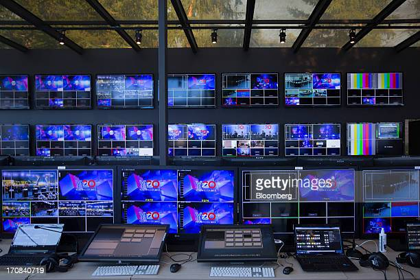 Logos for the Y20 business event sit on television screens in the broadcast control center at the St Petersburg International Economic Forum 2013...