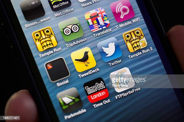 Logos for Twitter Inc's TweetDeck app center left and Twitter app center right are seen on the screen of an Apple Inc iPhone in this arranged...