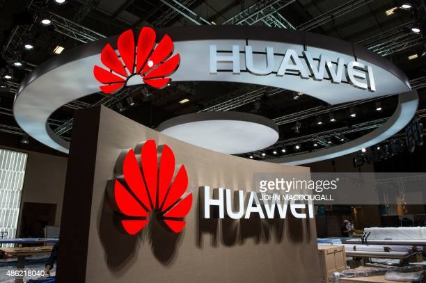 Logos of Chinese electronics giant Huawei are pictured at the company's booth ahead of the opening of the 55th IFA on September 2 2015 in Berlin IFA...