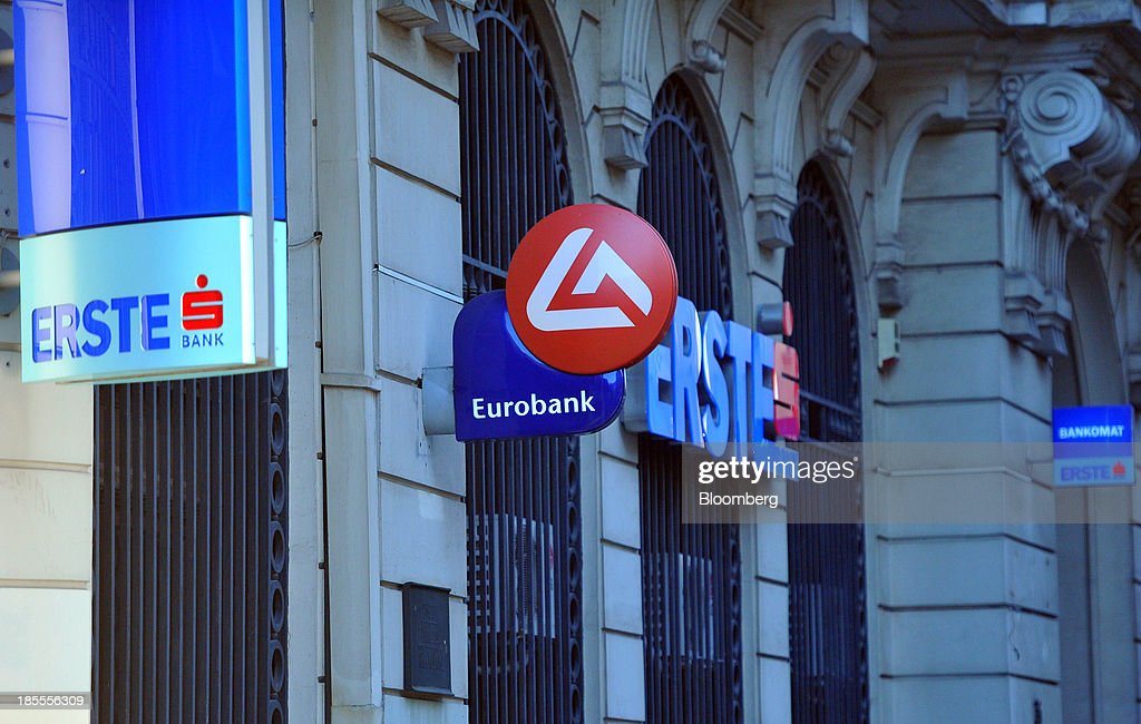 Logos of Erste bank, operated by Erste Group Bank AG, sit outside a branch of the bank in Belgrade, Serbia, on Sunday, Oct. 20, 2013. Serbia's government revealed a salvo of measures to bring the public finance deficit and debt back under control by 2017 after the head of the largest coalition party warned the country was on the brink of insolvency. Photographer: Oliver Bunic/Bloomberg via Getty Images