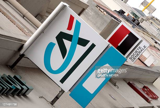 Logos of French banks Societe Generale and Credit Agricole on agencies' frontdoors are pictured on September 12 2011 in Rennes western France The...