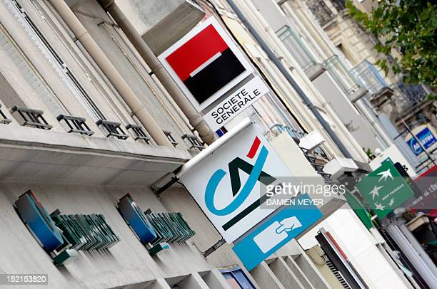 Logos of French banks Societe Generale Credit Agricole and BNP Paribas on agencies' frontdoors are pictured on September 12 2011 in Rennes western...