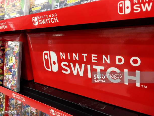 Logos of Nintendo Switch game console are seen at an electronics store in Tokyo Japan March 3 2017