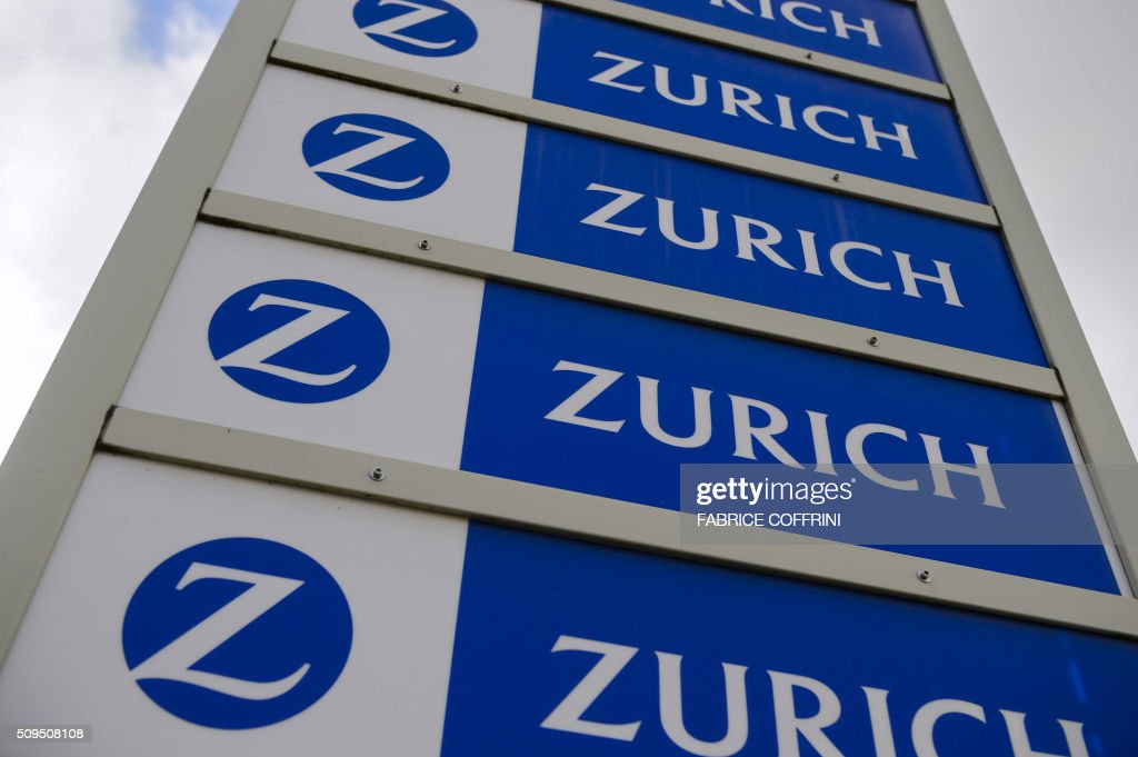 Logos of Zurich Insurance are seen on February 11, 2016 in Lausanne. The Swiss Zurich Insurance Group released the much lower figures for 2015, sealed by the costs of explosions in the Chinese port of Tianjin and the hurricanes in the United Kingdom and Ireland, but nevertheless decided to maintain its dividend. / AFP / FABRICE COFFRINI