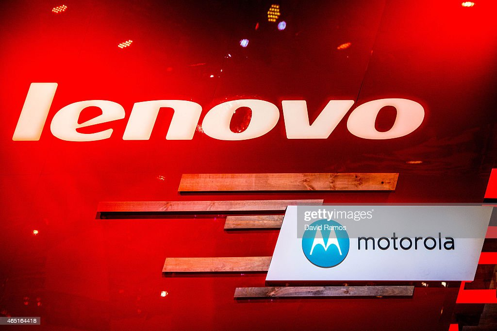 Logos sit illuminated outside the Lenovo and Motorola pavilion during the second day of the Mobile World Congress 2015 at the Fira Gran Via complex...