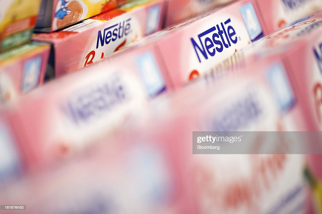 Logos sit on cartons of Nestle baby food displayed inside a store at the Nestle SA headquarters in Vevey, Switzerland, on Thursday, Feb. 14, 2013. Nestle SA said it expects 2013 to be as challenging as last year, when sales missed analysts' estimates on a slowdown in emerging markets, a region the world's largest food company is increasingly dependent upon. Photographer: Valentin Flauraud/Bloomberg via Getty Images