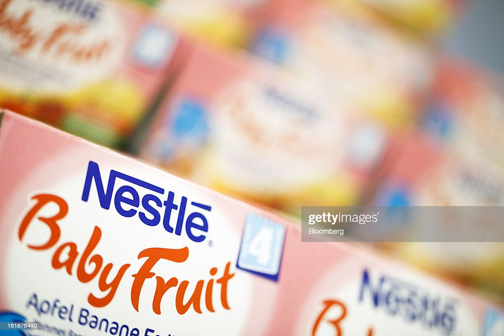 Logos sit on cartons of Nestle baby fruit food displayed inside a store at the Nestle SA headquarters in Vevey, Switzerland, on Thursday, Feb. 14, 2013. Nestle SA said it expects 2013 to be as challenging as last year, when sales missed analysts' estimates on a slowdown in emerging markets, a region the world's largest food company is increasingly dependent upon. Photographer: Valentin Flauraud/Bloomberg via Getty Images
