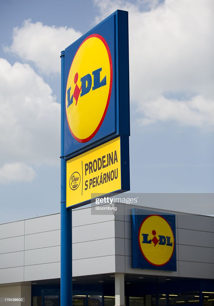 Logos sit on display outside a Lidl discount supermarket store, operated by Schwarz Group, in Prague, Czech Republic, on Thursday, June 13, 2013. Ahold and Tesco are tied as the Czech Republic's third-largest grocer by revenue behind Lidl discount store owner Schwarz Group and Rewe AV, which owns the Billa supermarkets, according to Krakow, Poland-based market researcher PMR. Photographer: Martin Divisek/Bloomberg via Getty Images