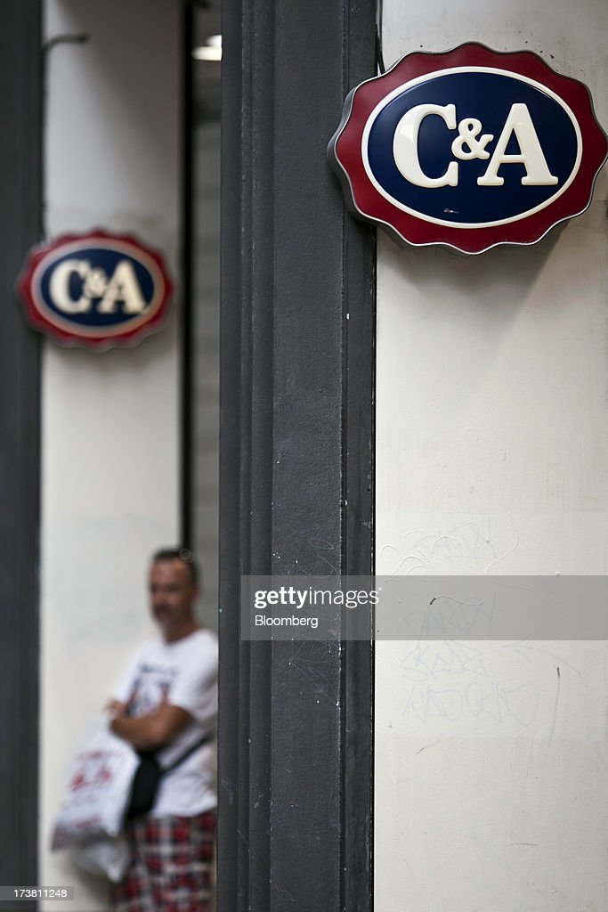Logos sit on display outside a store operated by the C&A Group in Bordeaux, France, on Wednesday, July 17, 2013. Austerity measures and rising unemployment are restraining consumer spending in Europe, while retailers including Groupe Auchan SA and Casino Guichard-Perrachon SA are competing more aggressively on price. Photographer: Balint Porneczi/Bloomberg via Getty Images