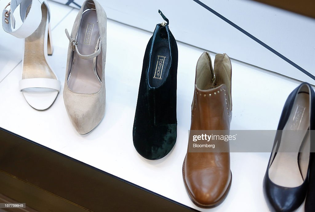 Logos sit on the insoles of women's footwear displayed for sale inside a Topshop store, owned by Arcadia Group Ltd., on Oxford Street in London, U.K., on Thursday, Dec. 6, 2012. Philip Green, the billionaire owner of the Arcadia fashion business, sold a 25 percent stake in the Topshop and Topman retail chains to Leonard Green & Partners LP, the co-owner of the J Crew fashion brand, in a deal valuing the businesses at 2 billion pounds ($3.2 billion). Photographer: Simon Dawson/Bloomberg via Getty Images