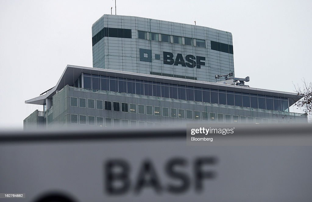 Logos sit on the outer walls of BASF SE's headquarters in Ludwigshafen, Germany, on Tuesday, Feb. 26, 2013. BASF SE forecast growth in earnings and sales this year after demand for plastics used to lighten cars and higher oil production buoyed quarterly earnings. Photographer: Ralph Orlowski/Bloomberg via Getty Images