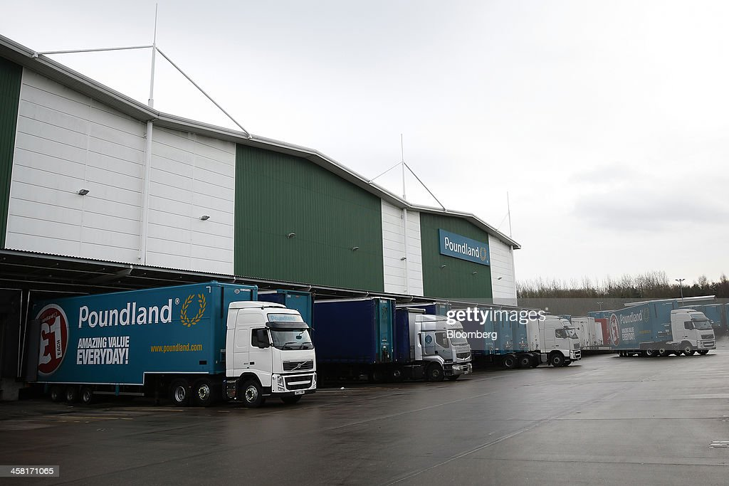 Logos sit on the side of delivery trucks at Poundland's goods distribution warehouse, operated by Poundland Holdings Ltd., in Bilston, U.K., on Friday, Dec. 20, 2013. U.K. discount retailer Poundland has hired Rothschild to manage its IPO, according to the Sunday Times newspaper. Photographer: Simon Dawson/Bloomberg via Getty Images