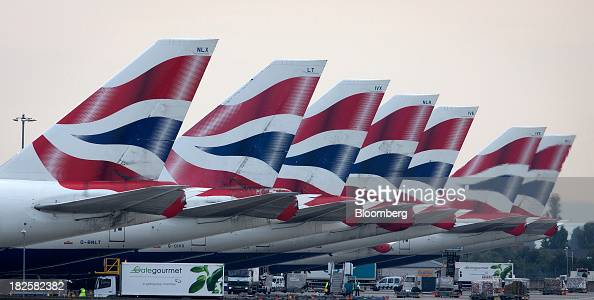 Logos sit on the tailfins of Boeing Co 747 aircraft operated by British Airways a unit of International Consolidated Airlines Group SA at Heathrow...