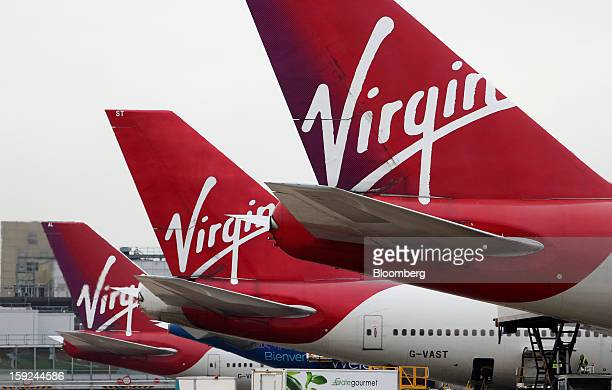 Logos sit on the tailfins of Virgin Atlantic aircraft at Gatwick airport in Crawley UK on Thursday Jan 10 2013 Gatwick acquired by Global...