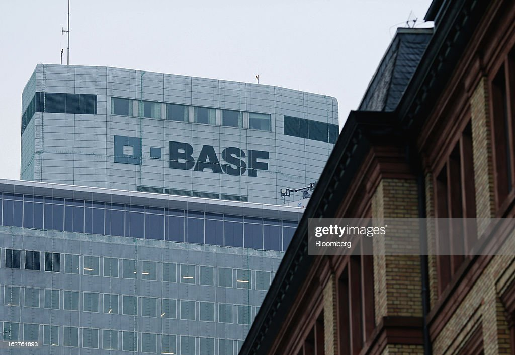 A logos sits on the outer walls of BASF SE's headquarters in Ludwigshafen, Germany, on Tuesday, Feb. 26, 2013. BASF SE forecast growth in earnings and sales this year after demand for plastics used to lighten cars and higher oil production buoyed quarterly earnings. Photographer: Ralph Orlowski/Bloomberg via Getty Images