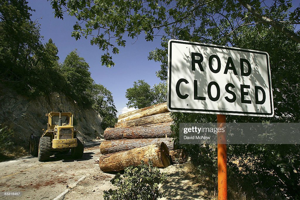 Logs block State Highway 173 which is normally one of only three major evacuation routes out of the area on August 1, 2005 near Lake Arrowhead, California. The trees, killed by a plague of pine beetles, are being removed as an emergency action to lessen a dangerous wildfire threat but Logger Steve Johnson complains that blocking the highway is a threat to residents. Last winter was one of the wettest on record, dropping 90 inches of rain in some southern California mountain areas and creating the thickest vegetation growth in memory, and damaging more than 2,000 miles of fire access roads used to protect 2.3 million acres of forests. In addition to the many thousands of trees killed by a massive pine beetle infestation, newly grown vegetation is drying up under triple-digit temperatures and raising fears of a repeat of the devastating fire season of 2003. President Bush signed an emergency funding bill in May allocating $25 million to fix roads in southern California?s national forests but Congress has acted slower than expected in providing the money so some of the repairs might not be done until October.