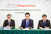 Loh Chin Hua chief executive officer of Keppel Corp center speaks while Chan Hon Chew chief financial officer of Keppel Corp left and Chow Yew Yuen...