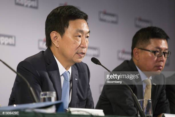 Loh Chin Hua chief executive officer of Keppel Corp left speaks as Ang Wee Gee chief executive office of Keppel Land Ltd listens during a news...