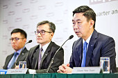 Loh Chin Hua chief executive officer of Keppel Corp right speaks while Chan Hon Chew chief financial officer of Keppel Corp center and Ang Wee Gee...