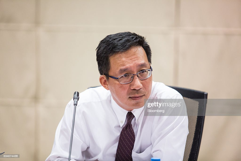 Loh Khum Yean, permanent secretary of Singapore's Ministry of Trade and Industry, listens during an economic briefing in Singapore, on Wednesday, May 25, 2016. Singapore's first-quarter economic growth was faster than the government earlier predicted, providing some relief for the trade-oriented nation as it faces sluggish global demand. Photographer: Nicky Loh/Bloomberg via Getty Images