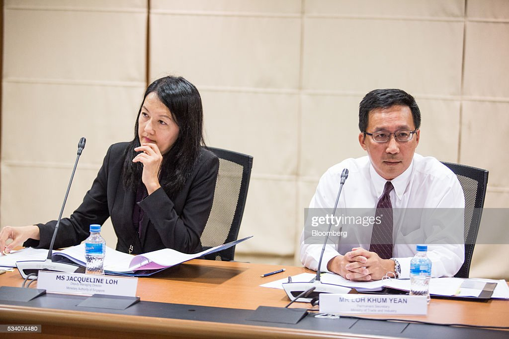 Loh Khum Yean, permanent secretary of Singapore's Ministry of Trade and Industry, right, and Jacqueline Loh, deputy managing director of the Monetary Authority of Singapore, attend an economic briefing in Singapore, on Wednesday, May 25, 2016. Singapore's first-quarter economic growth was faster than the government earlier predicted, providing some relief for the trade-oriented nation as it faces sluggish global demand. Photographer: Nicky Loh/Bloomberg via Getty Images