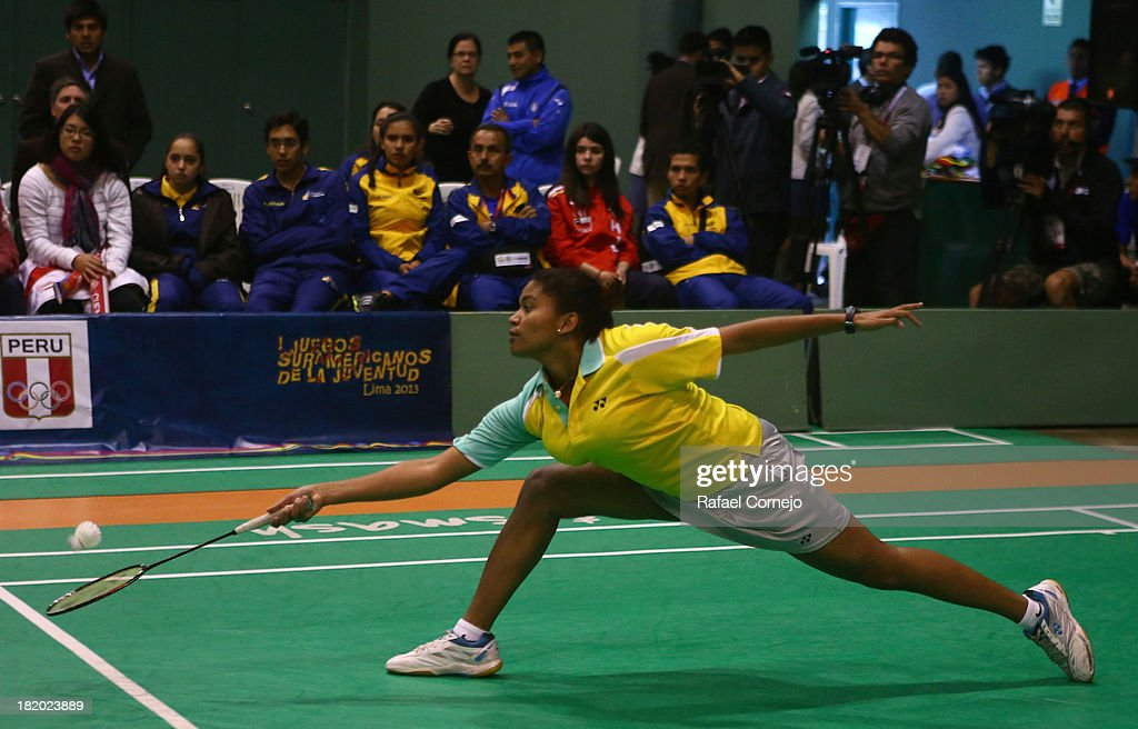 Lohaynny Caroline De Oliveira of Brazil makes a shot during her women's badminton final match as part of the I ODESUR South American Youth Games on September 27, 2013 in Lima, Peru.
