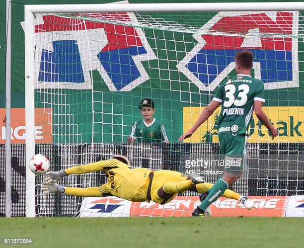 Loic Badiashile of AS Monaco vies with Philipp Prosenik of SK Rapid Wien during a friendly football match between SK Rapid Wien and AS Monaco on July...