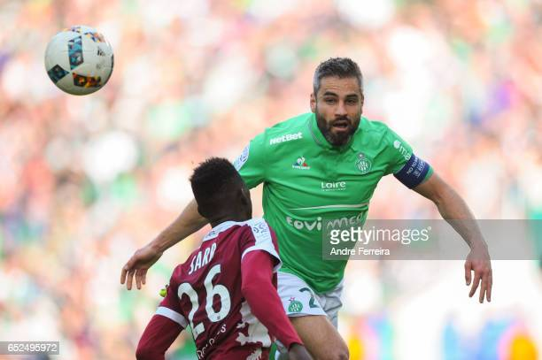 Loic Perin of Saint Etienne and Ismaila Sarr of Metz during the French Ligue 1 match between Saint Etienne and Metz at Stade GeoffroyGuichard on...