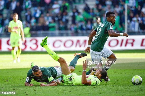 Loic Perrin of Saint Etienne Enzo Crivelli of Angers and Habib Maiga of Saint Etienne during the Ligue 1 match between AS Saint Etienne and Angers...