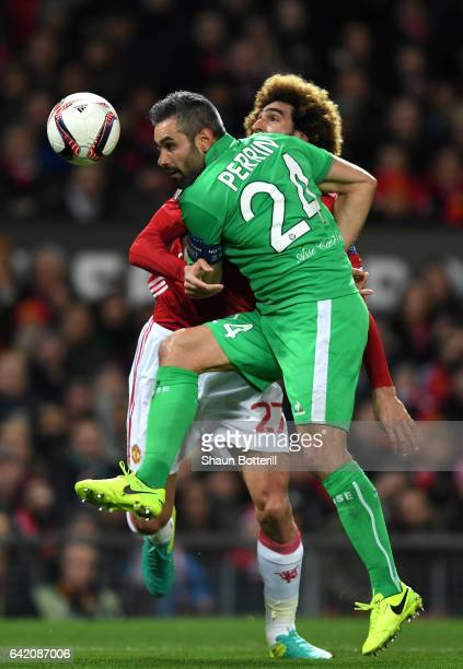 Loic Perrin of SaintEtienne and Marouane Fellaini of Manchester United during the UEFA Europa League Round of 32 first leg match between Manchester...