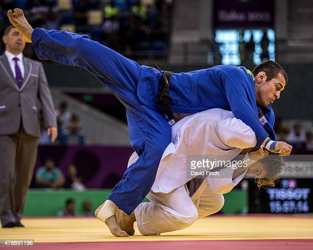 Loic Pietri of France throws Avtandili Tchrikishvili of Georgia to win the contest and secure France four wins to one and the team gold medal during...