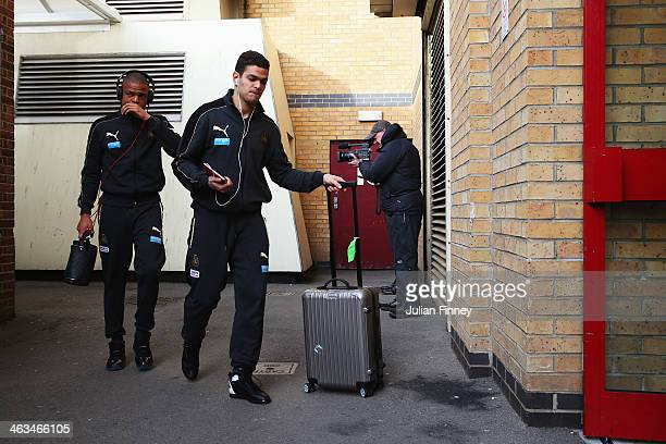 Loic Remy and Hatem Ben Arfa of Newcastle United arrive for the Barclays Premier League match between West Ham United and Newcastle United at the...