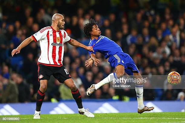 Loic Remy of Chelsea and Younes Kaboul of Sunderland compete for the ball during the Barclays Premier League match between Chelsea and Sunderland at...
